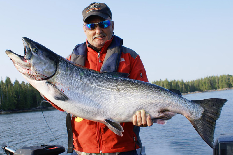 Captain Ron with a catch of a lifetime off Cheney Point, 30 minutes from the Shearwater, BC fishing base.  This location is full of salmon and quite often killer whales.